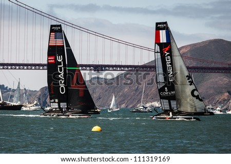 SAN FRANCISCO, CALIFORNIA, USA - AUGUST 25, 2012: Team Oracle USA, French Team Energy race in Louis Vuitton Cup part of America's Cup World Series on August 25, 2012 in San Francisco Bay, California - stock photo
