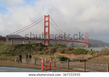 San Francisco, California, USA - December 22, 2015: The Golden Gate Bridge, a suspension bridge spanning the Golden Gate strait, is one of the most internationally recognized symbols of San Francisco. - stock photo