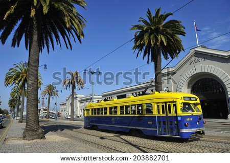SAN FRANCISCO, California, USA, - NOVEMBER. 10. 2011: Streetcar running on the street trail, propelled by electric motors and a trolley pole to draw power from an overhead, San Francisco - stock photo