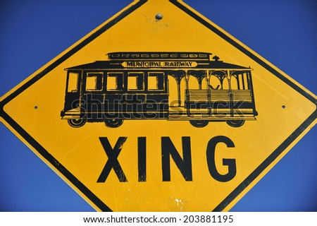 SAN FRANCISCO, California, USA, - NOVEMBER. 10. 2011: The crossing sign of cable car tram on the street in San Francisco, world's last manually-operated cable car system, icon of San Francisco - stock photo