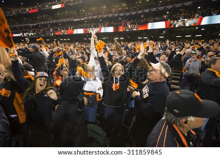 San Francisco, California, USA, October 16, 2014, AT&T Park, baseball stadium, SF Giants versus St. Louis Cardinals, National League Championship Series (NLCS) excited crowd Giants win 2014 NL Pennant - stock photo