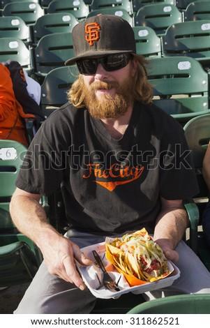 San Francisco, California, USA, October 16, 2014, AT&T Park, baseball stadium, SF Giants versus St. Louis Cardinals, National League Championship Series (NLCS), fan with hot dog - stock photo