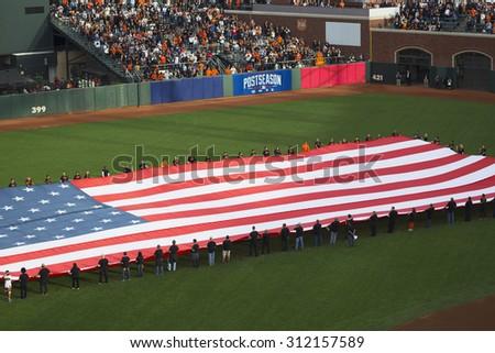 San Francisco, California, USA, October 16, 2014, AT&T Park, baseball stadium, SF Giants versus St. Louis Cardinals, National League Championship Series (NLCS), large US Flag opening ceremonies - stock photo