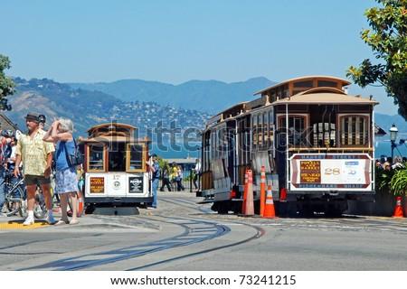 SAN FRANCISCO - CIRCA JUNE 2009: Cable car tram circa June 2009 in San Francisco, USA. The San Francisco cable car system is world last permanently operational manually operated cable car system. - stock photo