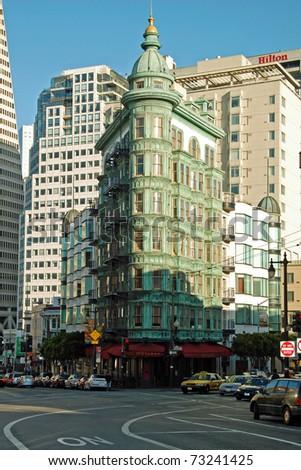 SAN FRANCISCO - CIRCA JUNE 2009: Victorian building circa June 2009 in San Francisco, USA. In San Francisco can be seen big contrast between modern architecture and old architecture from Victorian era. - stock photo