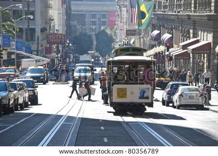SAN FRANCISCO - CIRCA NOV 2008: The Cable car tram November 7, 2008 in San Francisco, USA. The San Francisco cable car system is world last permanently manually operated cable car system. - stock photo