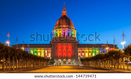 San Francisco City Hall illuminated in rainbow colors in honor of Pride Week.