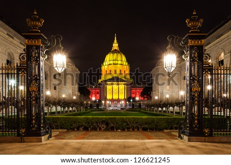 San Francisco City Hall illuminated in red and gold light to celebrate the Forty Niners. - stock photo