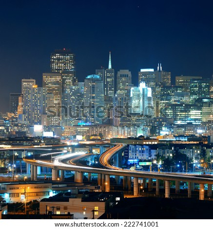 San Francisco city skyline with urban architectures at night with highway bridge. - stock photo