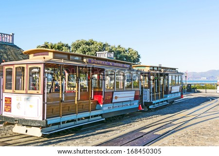 SAN FRANCISCO - DEC 9: Famous Cable Car near Fishermans Wharf on December 9, 2013 in San Francisco, California. Cable car trains first began operating in the city in 1873. - stock photo