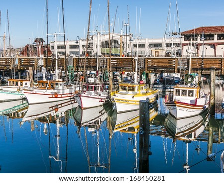 SAN FRANCISCO - DEC 9: sailing boats at Fishermans Wharf on December 9, 2013 in San Francisco, USA.  Fishermans Wharf gets its name in the mid to later 1800s when Italian fishermen came to the city. - stock photo