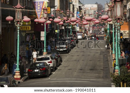 SAN FRANCISCO - DECEMBER 30: Daytime at Chinatown on December 30, 2013 in San Francisco, USA. San Francisco's Chinatown is one of North America's largest Chinatowns. - stock photo