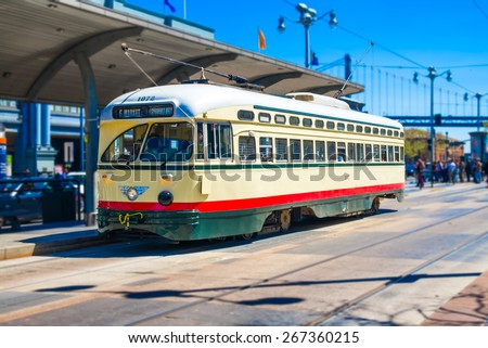 San Francisco f- streetcar, tram or muni cable trolley car traveling down the Embarcadero on a sunny day.  Vintage streetcar originally a Mexico City car built in 1946 trolley.  Tribute livery. - stock photo