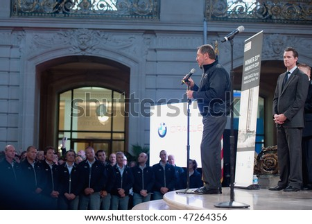 SAN FRANCISCO - FEB 20: SFO  CEO Larry Ellison speaks to his crew with mayor Gavin Newsom looking on at City Hall on Feb 20, 2010 in San Francisco - stock photo