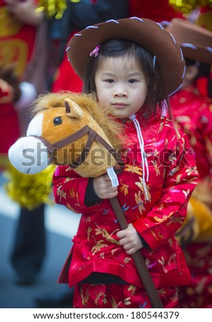 SAN FRANCISCO - FEB 15 : Unidentified dress up children performing during the Chinese New Year Parade in San Francisco , CA on February 15 2014 , It is the largest Asian event in North America