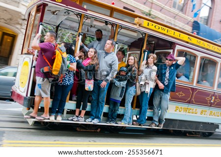 SAN FRANCISCO - FEBRUARY 14: Passengers enjoy a ride in a cable car on FEBRUARY 14, 2015 in San Francisco - stock photo