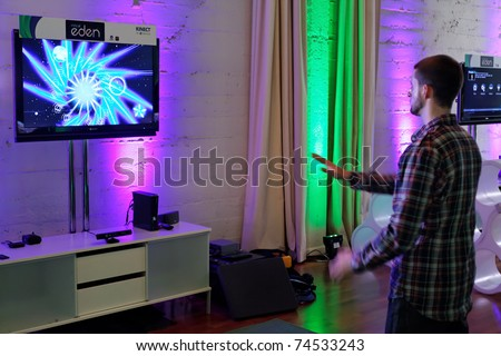 SAN FRANCISCO - FEBRUARY 23: Unidentified video game journaist Playing with Kinect, Xbox 360 and Child of Eden at a Microsoft Press Event on February 23, 2011 in San Francisco, CA - stock photo