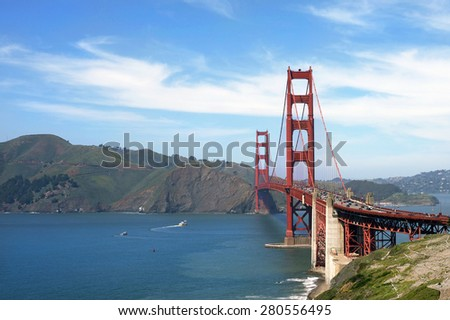 San Francisco Golden Gate Bridge with blue skies white clouds sunny day