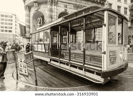 SAN FRANCISCO - JUN 24: Famous Cable Car on June 24, 2012 in San Francisco. It is the oldest mechanical public transport in San Francisco which is in service since 1873 - stock photo