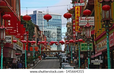 SAN FRANCISCO - JUN 22: The busy streets and marketplace of Chinatown in San Francisco, CA. Taken June 22, 2012 in San Francisco, CA. - stock photo