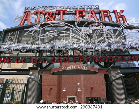 SAN FRANCISCO - JUNE 7: AT&T Park - Home of the Giants - Neon Sign during day  as people enter park for ballgame June 7 2011 Att Park San Francisco California. - stock photo