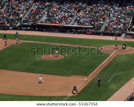 SAN FRANCISCO - JUNE 16: Giants Vs. Orioles: Giants Cy Young award winner Tim Lincecum throws pitch in mid-air with runner on first during a day game.  June 16 2010 Att Park San Francisco California - stock photo