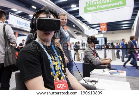 SAN FRANCISCO - MARCH 20: Oculus VR unveiling the second version of The Rift, its Virtual Reality headset for PC just before being bought by Facebook at GDC 2014 on March 20, 2014 in San Francisco, CA - stock photo