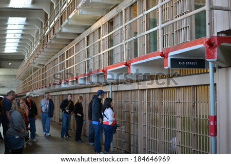 SAN FRANCISCO - MARCH 22: Tourist visiting the Alcatraz Island Prison on March 22, 2014 in San Francisco, California.  Alcatraz is one of the most infamous prisons in American history. - stock photo