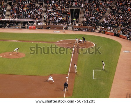 SAN FRANCISCO - MAY 11: Giants Vs. Padres: Pitcher Barry Zito throwing a pitch with runner on third and David Eckstien batting during a night game.  May 11 2010 at Att Park San Francisco California - stock photo