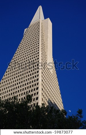 SAN FRANCISCO- MAY 22: The white quartz Transamerica Pyramid Building and moon in downtown on May 22, 2010 in San Francisco, California - stock photo