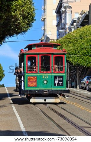 SAN FRANCISCO - NOVEMBER 26: Cable car runs on November 26, 2010 in San Francisco, California. Cable car is the oldest mechanical public transport in San Francisco which is in service since 1873 - stock photo