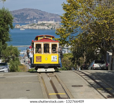 SAN FRANCISCO - NOVEMBER 2012: The Cable car tram, November 2nd, 2012 in San Francisco, USA. The San Francisco cable car system is world last permanently manually operated cable car system. - stock photo