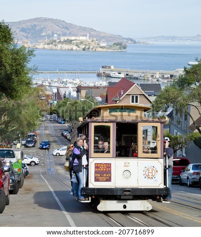 SAN FRANCISCO - NOVEMBER 2: The Cable car tram, November 2nd, 2012 in San Francisco, USA. The San Francisco cable car system is world last permanently manually operated cable car system. - stock photo