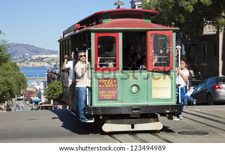 SAN FRANCISCO - NOVEMBER 3: The Cable car tram, November 3rd, 2012 in San Francisco, USA. The San Francisco cable car system is world last permanently manually operated cable car system. - stock photo