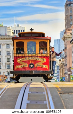 SAN FRANCISCO - NOVEMBER 26:Unidentified passengers enjoy a ride in a cable car on Nov. 26, 2010 in San Francisco, California. It is the oldest mechanical public transport in San Francisco which is in service since 1873. - stock photo
