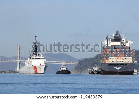 SAN FRANCISCO - NOVEMBER 11: USCGC Bertholf (WMSL 750) first Legend-class maritime security cutter of the United States Coast Guard. Ship is entering the Oakland California Harbor on November 11, 2012 - stock photo