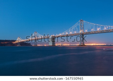 San Francisco-??Oakland Bay Bridge is part of Interstate 80 and the direct road route between San Francisco and Oakland. - stock photo
