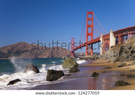 SAN FRANCISCO -OCTOBER 19: Golden Gate Bridge on October 19, 2011 in San Francisco, USA. The Bridge was opened on May 27, 1937. It has the longest span in the world-1,280 m and total length 2,737 m. - stock photo