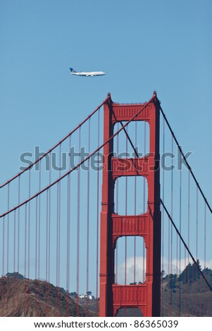 SAN FRANCISCO - OCTOBER 7: 747 Jumbo jet flies low over the Golden Gate Bridge and San Francisco Bay during Fleet Week celebration on October 7, 2011 in SAN FRANCISCO.