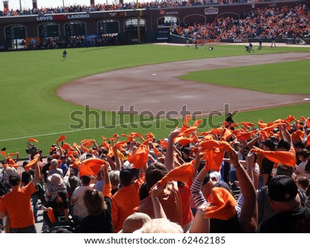 SAN FRANCISCO - OCTOBER 2: Padres vs. Giants: Fans wave orange towels to pump up team before the start of the game.  taken on October 2 2010 at Att Park in San Francisco California. - stock photo