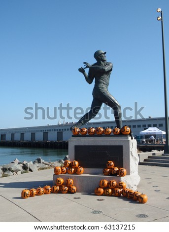 SAN FRANCISCO - OCTOBER 7: Willie McCovey Statue with Pumpkins with black writing cheering on the 2010 San Francisco Giants taken October 7 2010 San Francisco. - stock photo