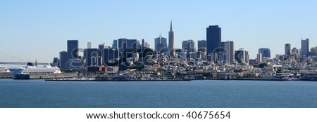 San Francisco panorama on a beautiful day.  Bay Bridge, cruise ships, Coit Tower, and downtown can all be seen. - stock photo