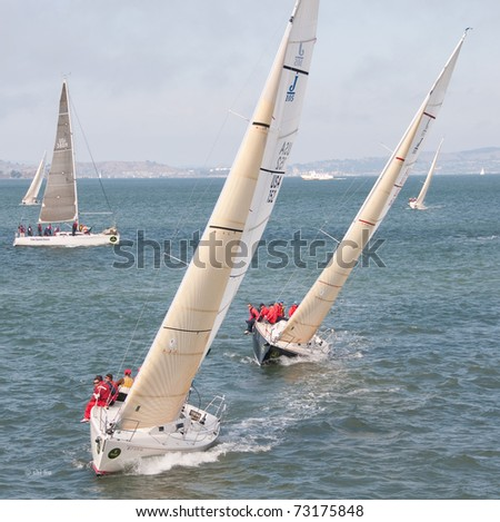 SAN FRANCISCO - SEPT 12: two j105s on starboard tacks, compete at the 45th Rolex Big Boat Series on Sept 12, 2009 in San Francisco Bay, California