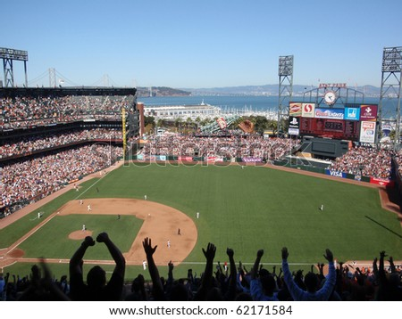 SAN FRANCISCO - SEPTEMBER 30: Diamondbacks vs. Giants: Fans arms in air after homerrun by Buster Posey as he trots toward 3rd as he rounds bases. September 30 2010 Att Park San Francisco California - stock photo