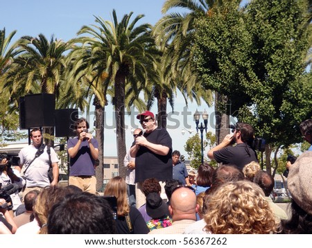 SAN FRANCISCO - SEPTEMBER 17: Filmmaker Michael Moore speaks in front of crowd at Justin Herman Plaza in San Francisco to promote a new movie and his causes.  Taken September 17 2009 in San Francisco - stock photo