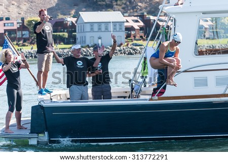 SAN FRANCISCO - SEPTEMBER 06, 2015: Grace van der Byl begins her first swim in a world record attempt for the longest relay open water swim in San Francisco Bay on September 06, 2015.   - stock photo