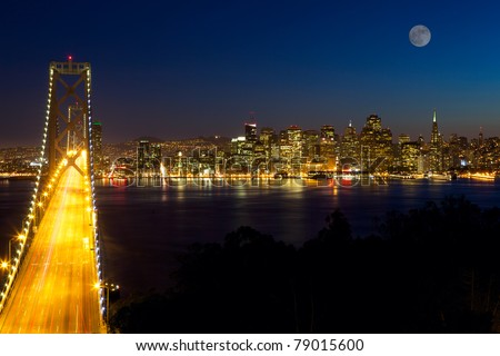 San Francisco skyline and Bay Bridge at night, California, USA - stock photo