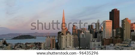 San Francisco skyline at sunset, with Treasure Island and Bay Bridge - stock photo