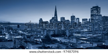 San Francisco skyline with Bay Bridge at twilight. - stock photo