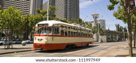 San Francisco Trolley Car moves through the street - stock photo
